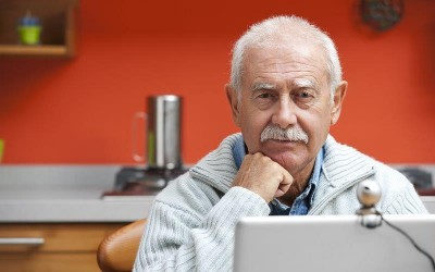 bigstock_Senior_man_speaking_video_webcam_webex_27550142-video