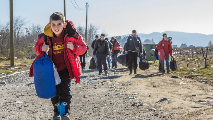 Gevgelija, Macedonia - December 23, 2015: Refugees arriving at the refugee camp of Vinojug in Gevgelija (Macedonia) after having crossed the border with Greece at Eidomeni.