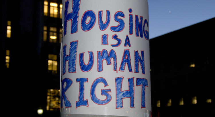 """Protest sign that reads, """"Housing is a human right"""" seen in Washington D.C. during a rally for equal housing opportunities."""