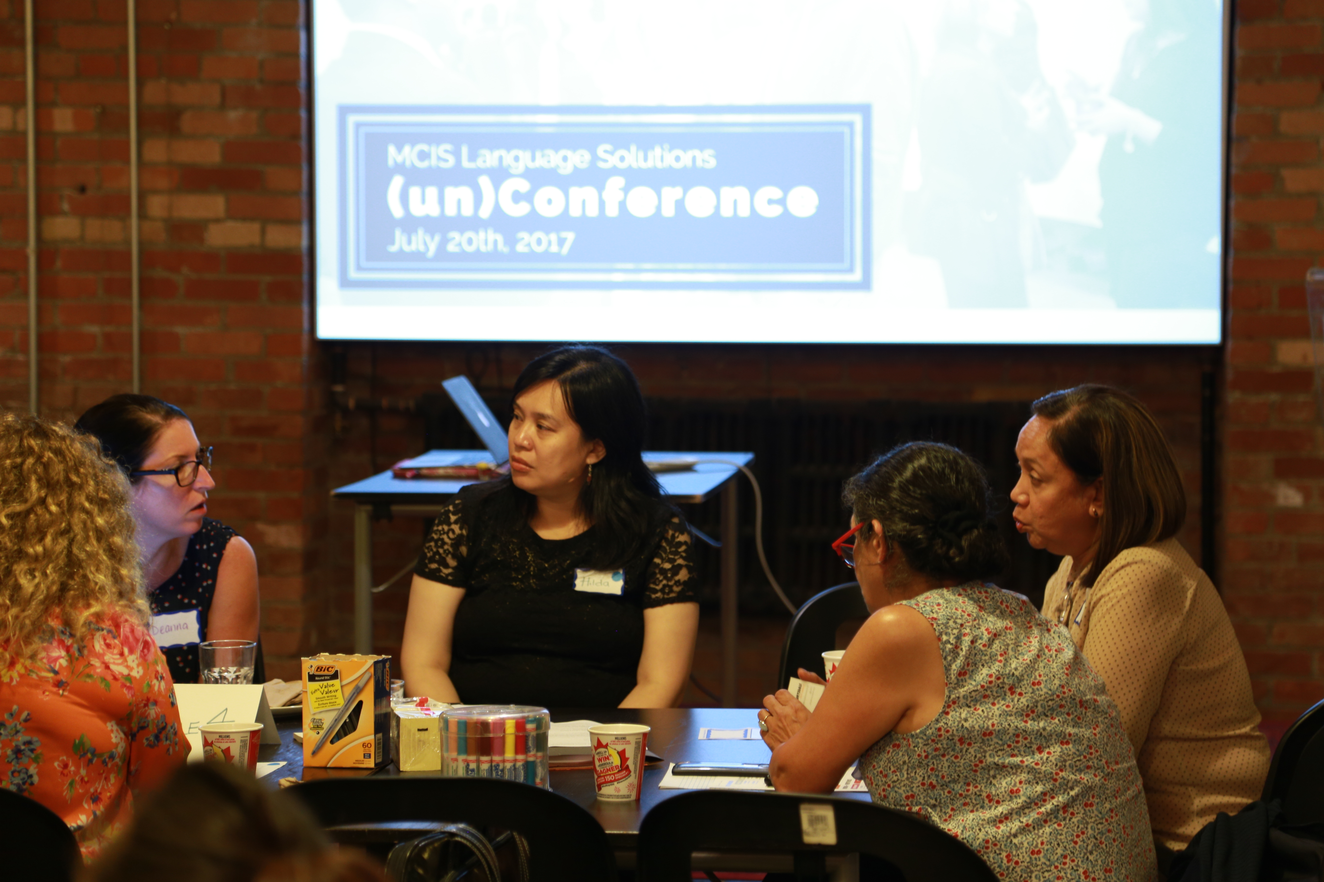 group discussion- unconference logo in back