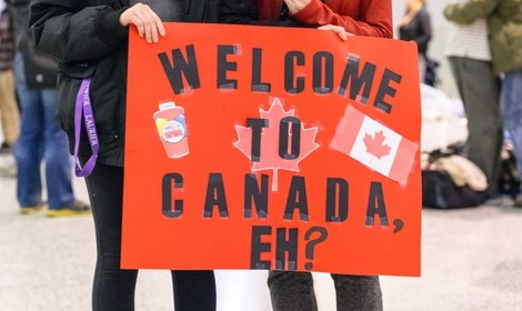 Toronto, Canada - December 11, 2015: Sponsors, family, and Canadians simply wishing to welcome their new neighbours await the first plane's arrival of Syrian refugees at Toronto's Pearson International Airport.