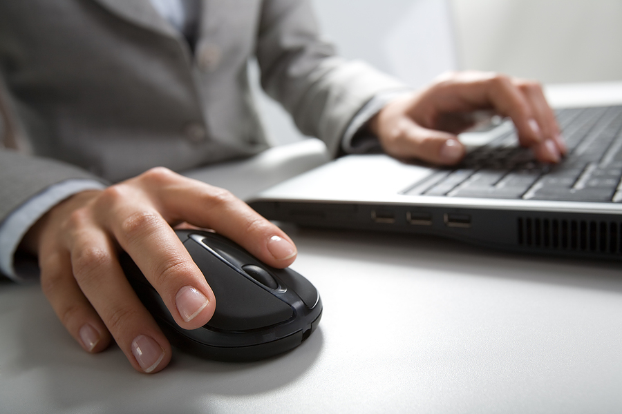 bigstock_Hand_clicking_mouse_keyboard_3387634