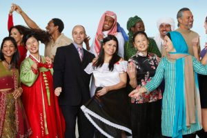 People in diverse cultural outfits
